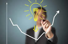 Male person drawing a bulb that stands for the idea and creativity